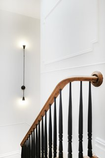 The revamped staircase blends traditional and modern.