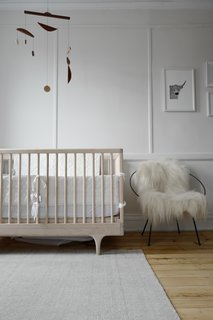Scandinavian-inspired furnishings and a midcentury modern mobile create a stylish kid's room.