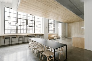 The wood slats suspended from the ceiling draw warmth into the room while improving acoustics in the open space.