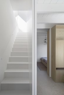 White walls and ceilings allow daylight to bounce and filter through the interior spaces.
