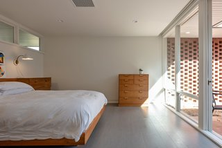 In the master bedroom, Durell's custom-designed bed and dresser remain.