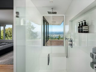 Even in the master bathroom, the views do not go unnoticed.  A picture window perfectly frames Mount Hood in the distance.