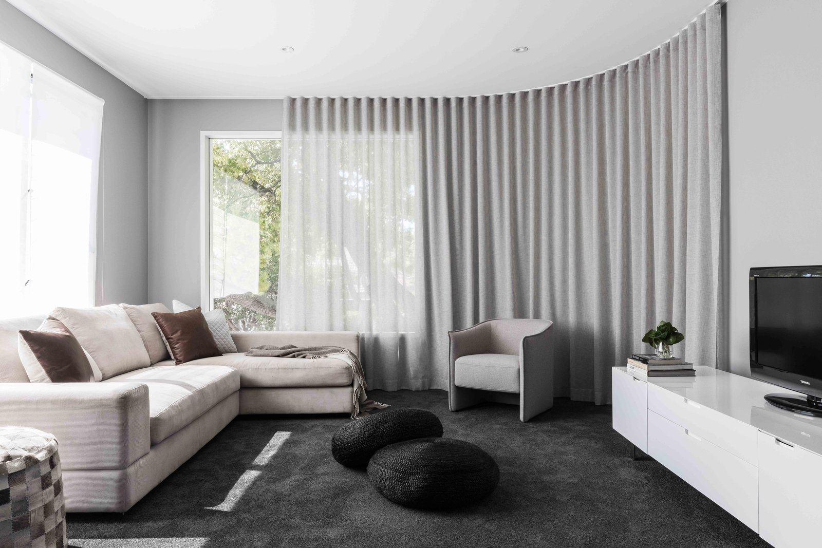 Living Room, Chair, Sofa, and Ottomans  The Rose Bay House by Prebuilt