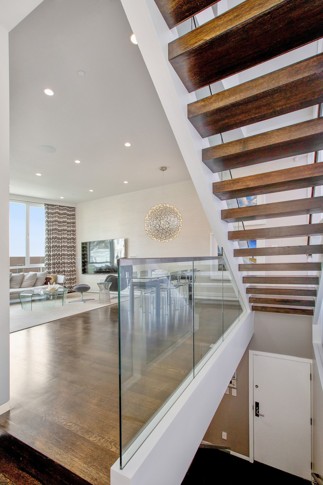Staircase, Wood Tread, and Glass Railing  LEED Platinum House in SF by DNM Architecture
