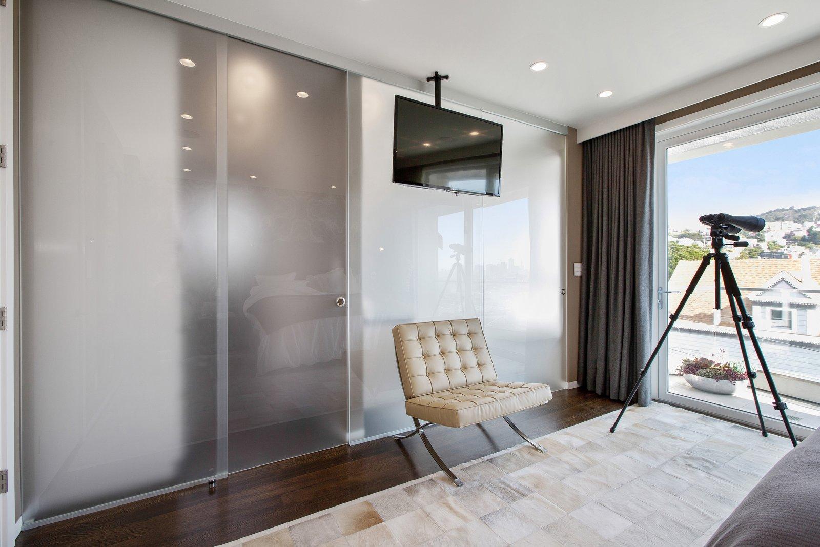 Bedroom, Ceiling Lighting, and Medium Hardwood Floor  LEED Platinum House in SF by DNM Architecture
