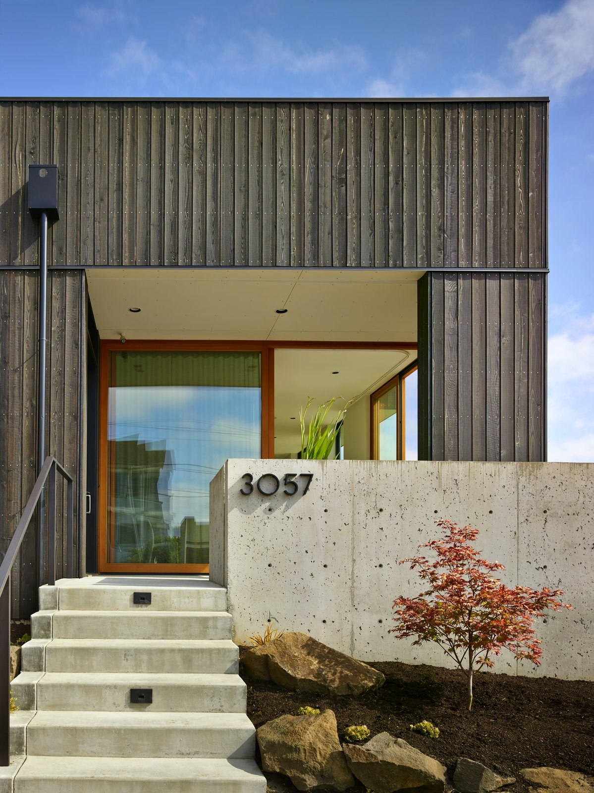 Front Yard, Slope, Trees, Boulders, Hardscapes, Concrete Patio, Porch, Deck, Side Yard, Doors, Exterior, and Sliding Door Type  BLK_LAB by Patano Studio Architecure