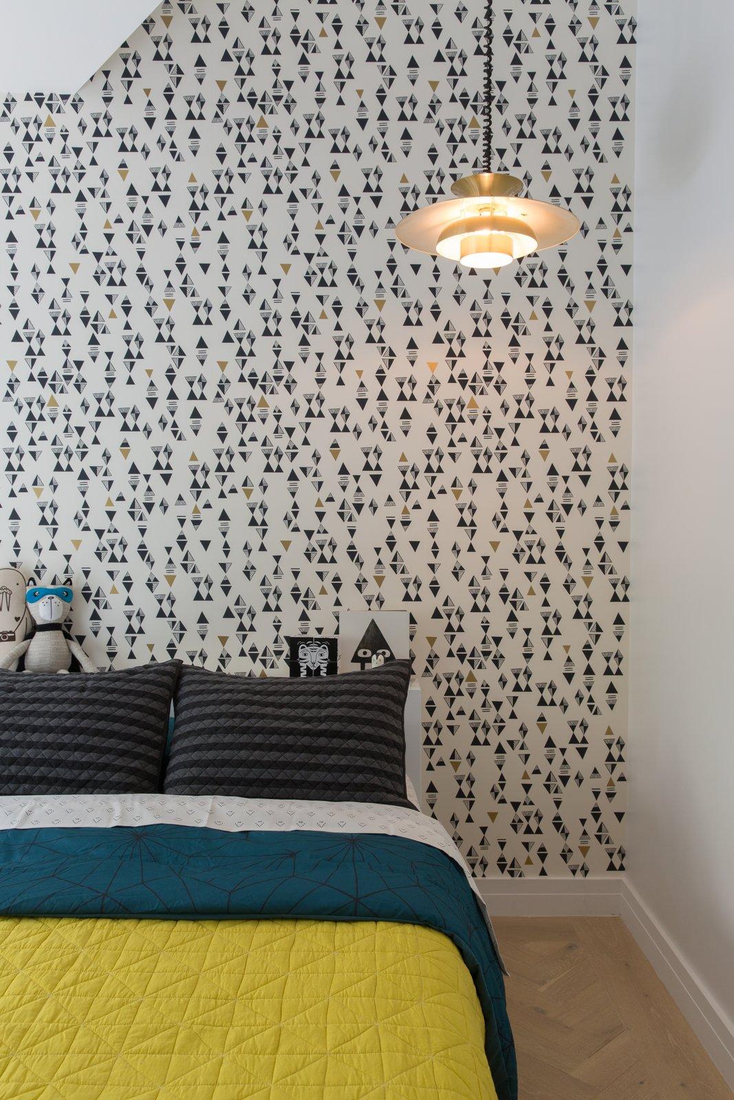 Bedroom, Light Hardwood Floor, Pendant Lighting, Recessed Lighting, and Bed  Best Photos from 1980s Modern Meets The New Millennium