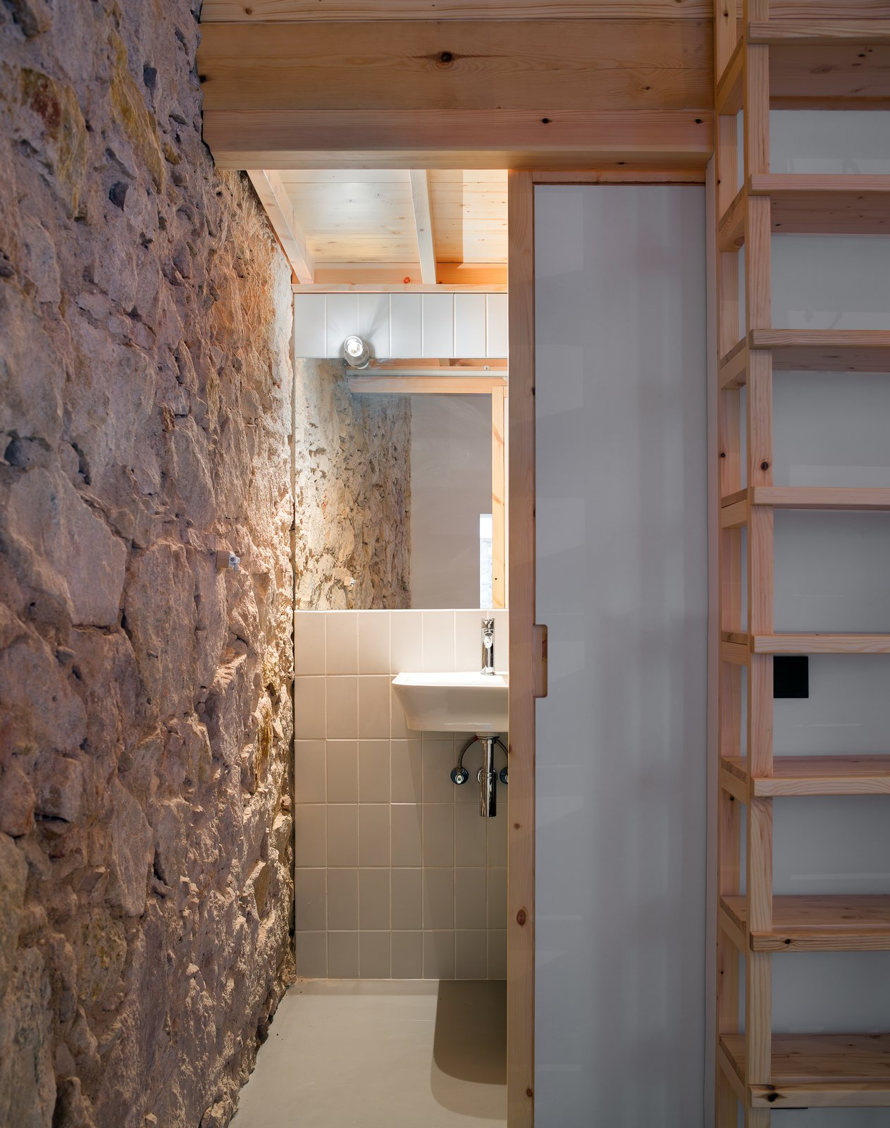 Bath Room, Wall Mount Sink, Accent Lighting, and Stone Slab Wall  Can Ghalili by LoCa Studio