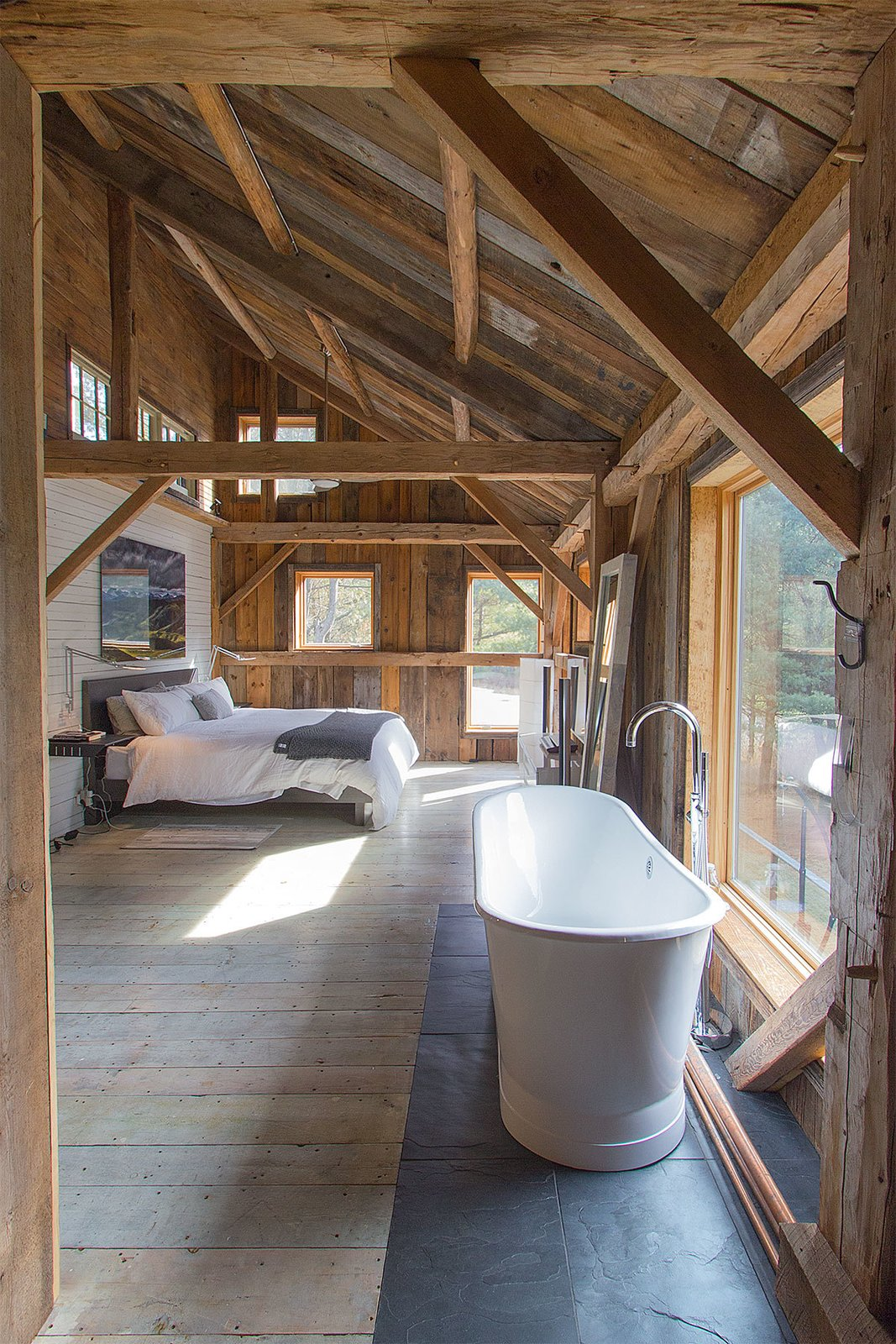 Bedroom, Night Stands, Light Hardwood Floor, Ceiling Lighting, and Bed  Best Photos from Vintage Barn