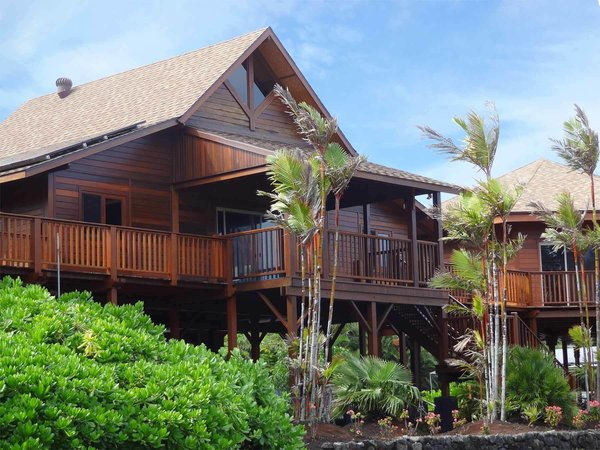 Three structures are connected by a large wrapping deck. The walls of Kapoho are finished in Mango wood.  Photo 6 of 8 in 7 Hawaiian Prefabs and Kit Homes