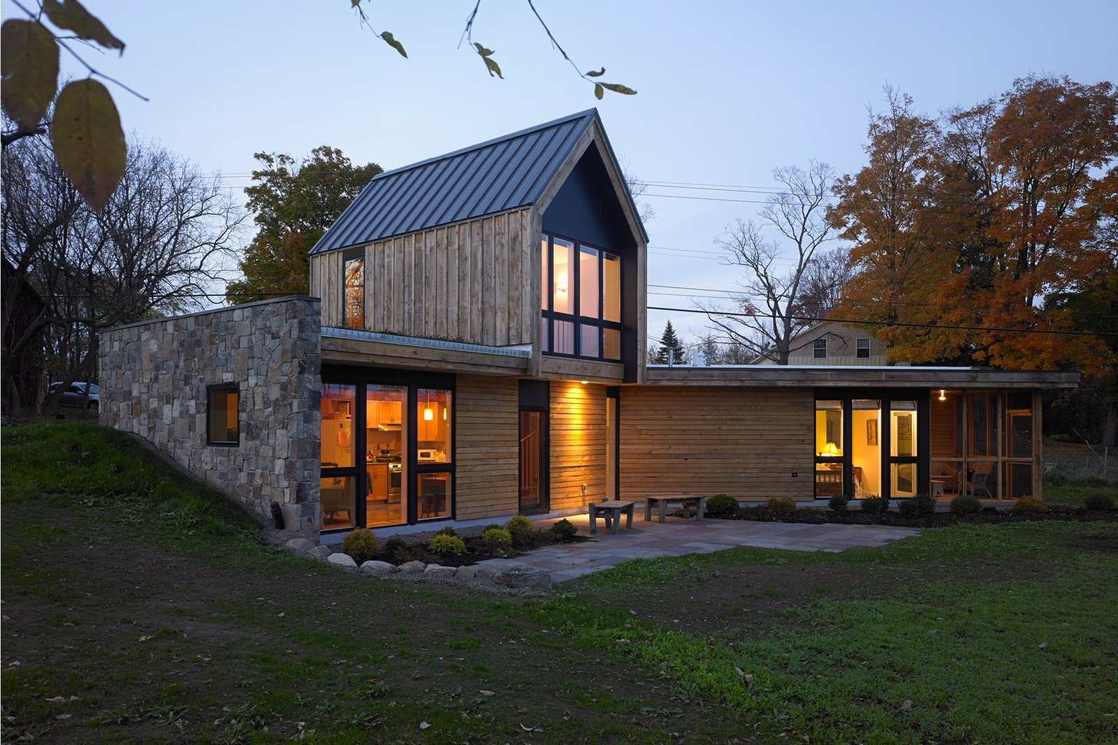 Exterior, Gable RoofLine, Metal Roof Material, House Building Type, Farmhouse Building Type, Wood Siding Material, Stone Siding Material, and Flat RoofLine  Best Photos from GRANNYcottage