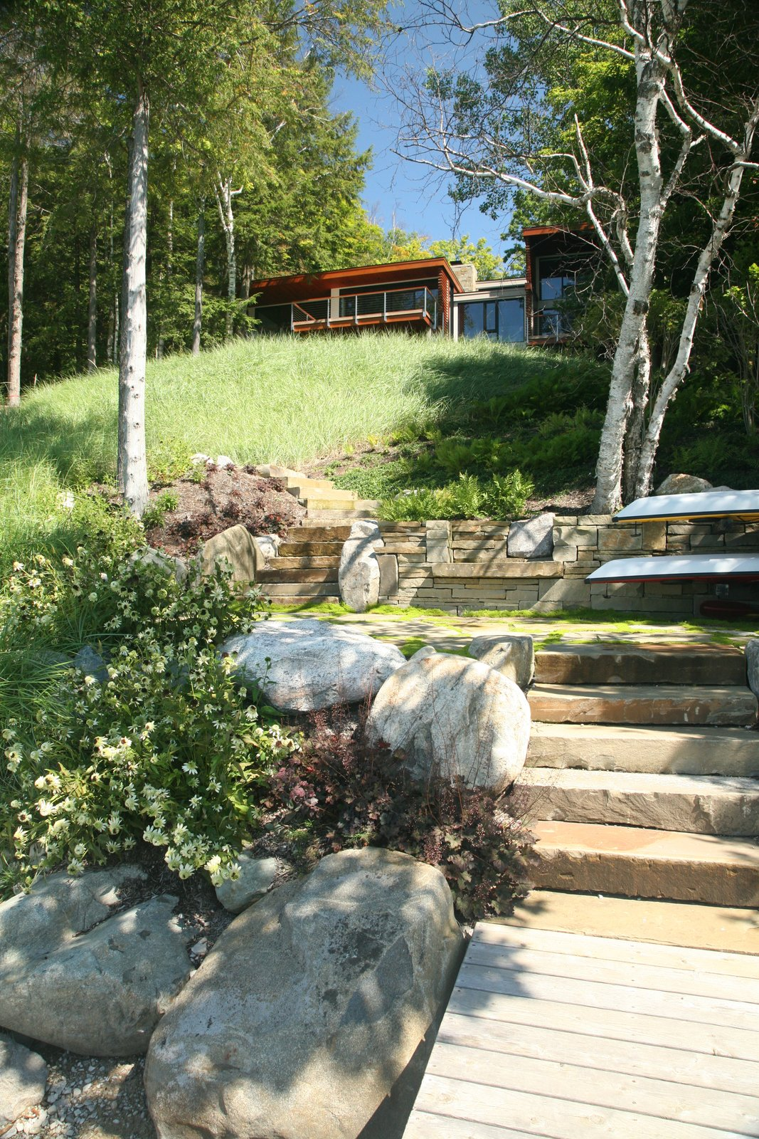 Outdoor, Back Yard, Slope, Field, Woodland, Garden, Shrubs, Trees, Grass, Walkways, Gardens, Hardscapes, Wood, Boulders, Flowers, Landscape, Large, Small, Pavers, and Stone  Best Outdoor Stone Boulders Photos from Walloon Lake House