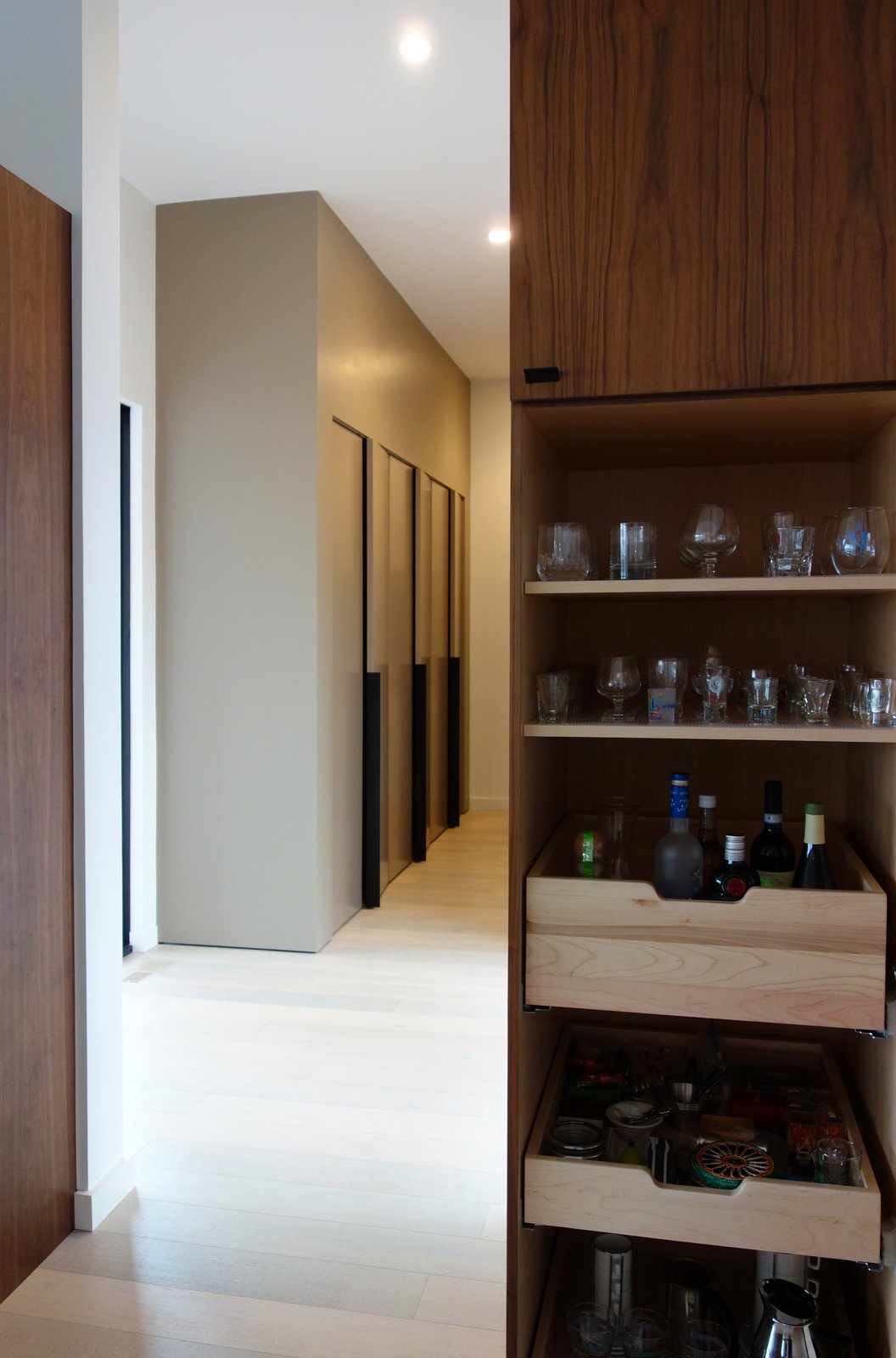 Kitchen, Wood Cabinet, Light Hardwood Floor, and Ceiling Lighting  Long House HS by Matthew Dudzik