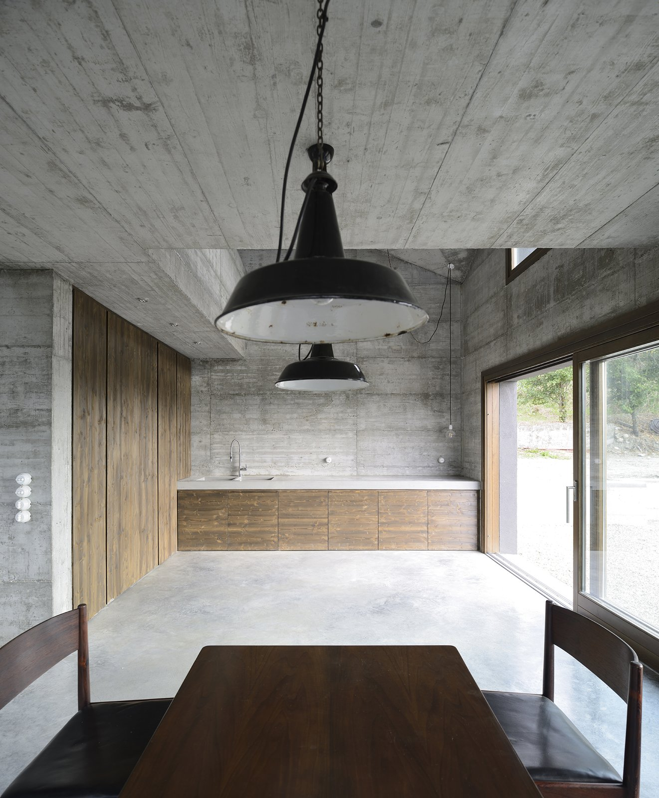 Tagged: Kitchen, Wood Counter, Concrete Counter, Concrete Floor, Table Lighting, Pendant Lighting, Ceiling Lighting, and Dishwasher.  HOUSE R