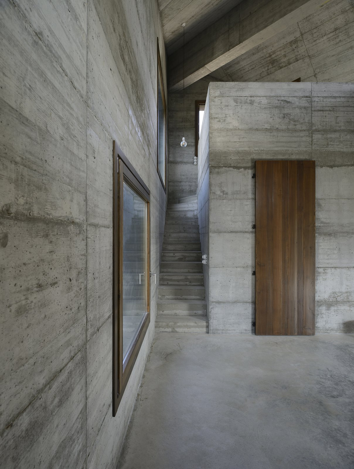 Living Room, Pendant Lighting, and Concrete Floor  HOUSE R