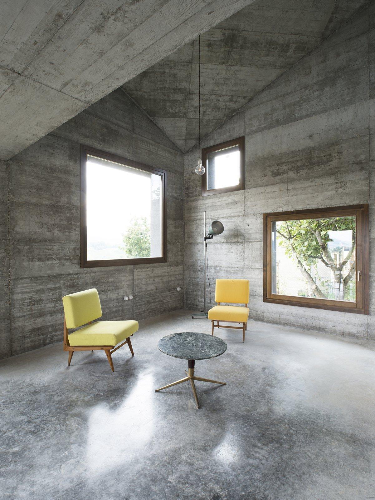 Living Room, Chair, Sofa, End Tables, Ceiling Lighting, Pendant Lighting, Floor Lighting, and Concrete Floor  HOUSE R