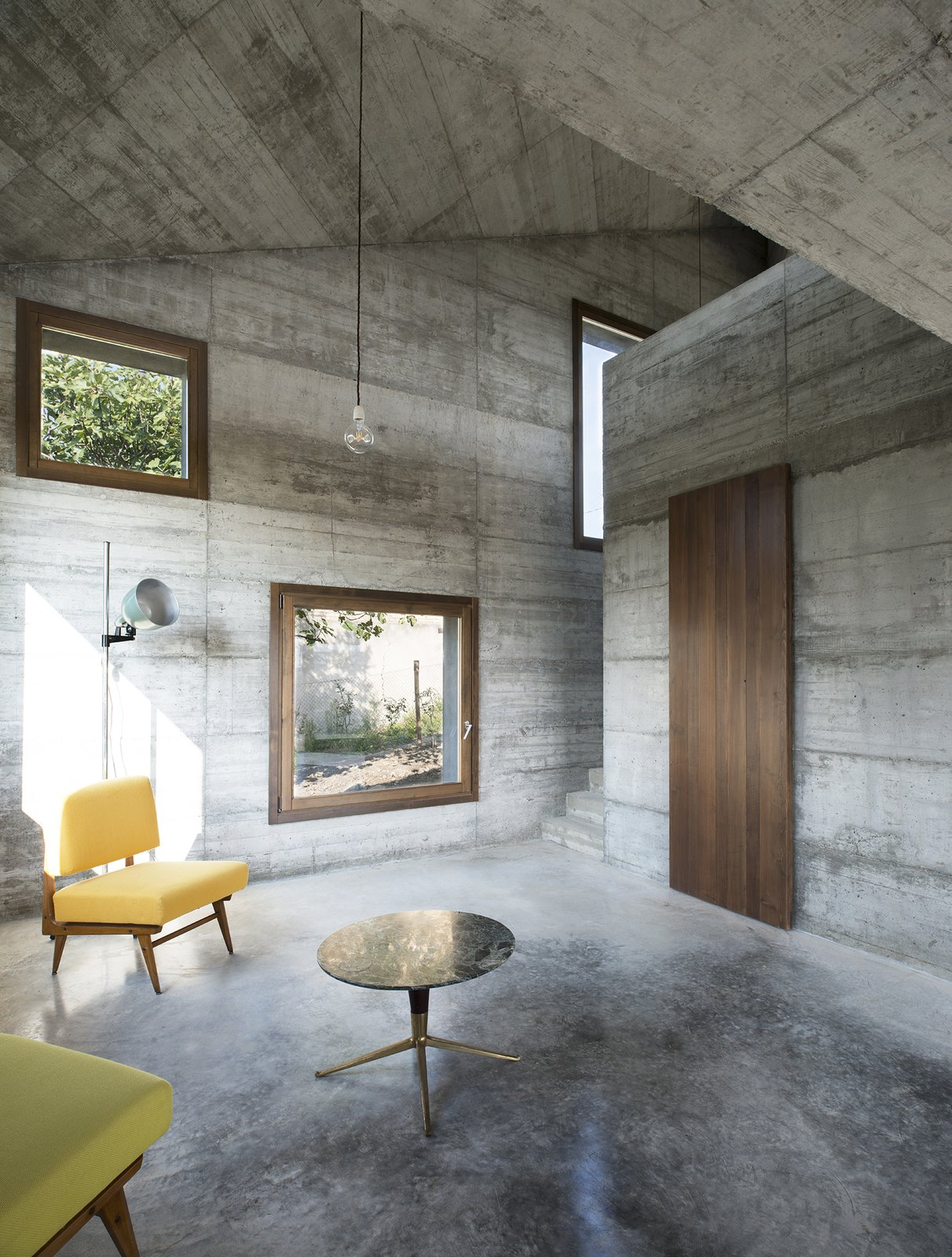 Living Room, Coffee Tables, Sofa, Concrete Floor, and Pendant Lighting  HOUSE R
