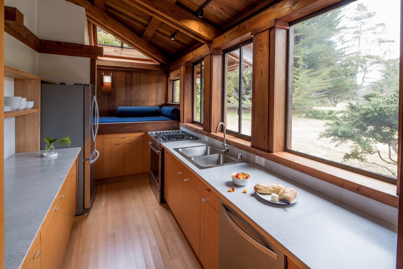 Kitchen, Wood Cabinet, Light Hardwood Floor, Track Lighting, Drop In Sink, Range, and Concrete Counter  Best Photos from Hinoki House
