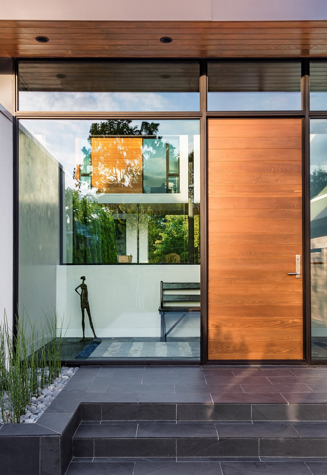 Exterior, Swing Door Type, Metal, Picture Window Type, Outdoor, Front Yard, Tile Patio, Porch, Deck, and Raised Planters  Calhoun Pavilions Residence by Peterssen/Keller Architecture
