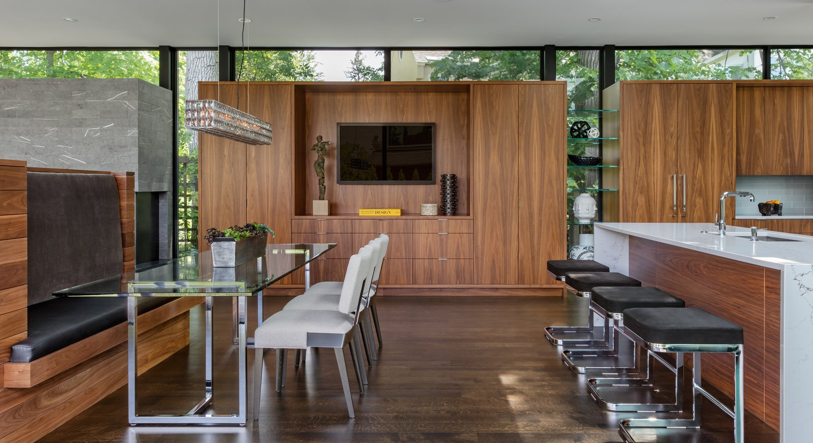 Chair, Table, Bench, Storage, Accent Lighting, Pendant Lighting, Stools, Bar, Dark Hardwood Floor, Engineered Quartz Counter, Dining Room, Drop In Sink, and Ceiling Lighting  Calhoun Pavilions Residence by Peterssen/Keller Architecture