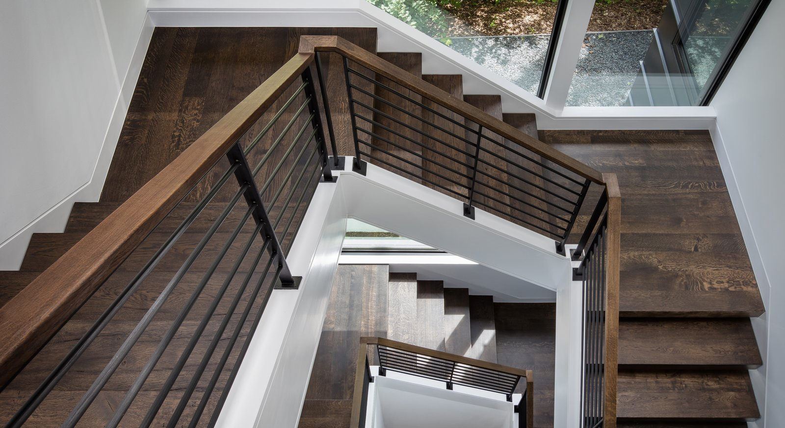 Staircase, Wood Tread, and Metal Railing  Calhoun Pavilions Residence by Peterssen/Keller Architecture