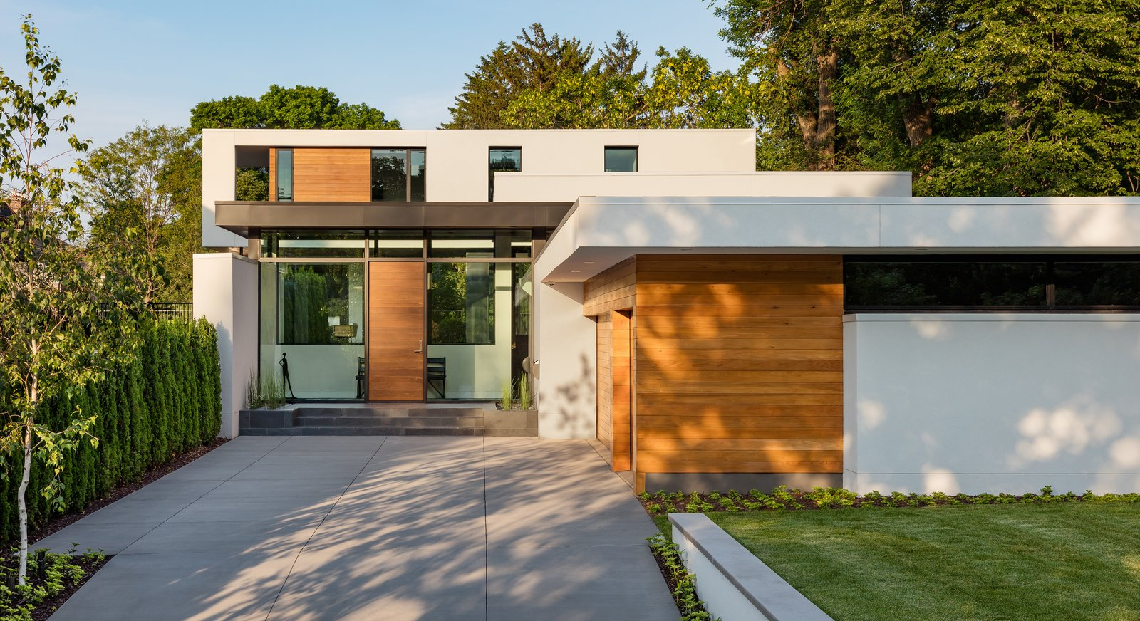 Attached Garage Room Type, Front Yard, Wood, Swing Door Type, Exterior, Metal, Outdoor, Trees, Garden, and Raised Planters  Calhoun Pavilions Residence by Peterssen/Keller Architecture