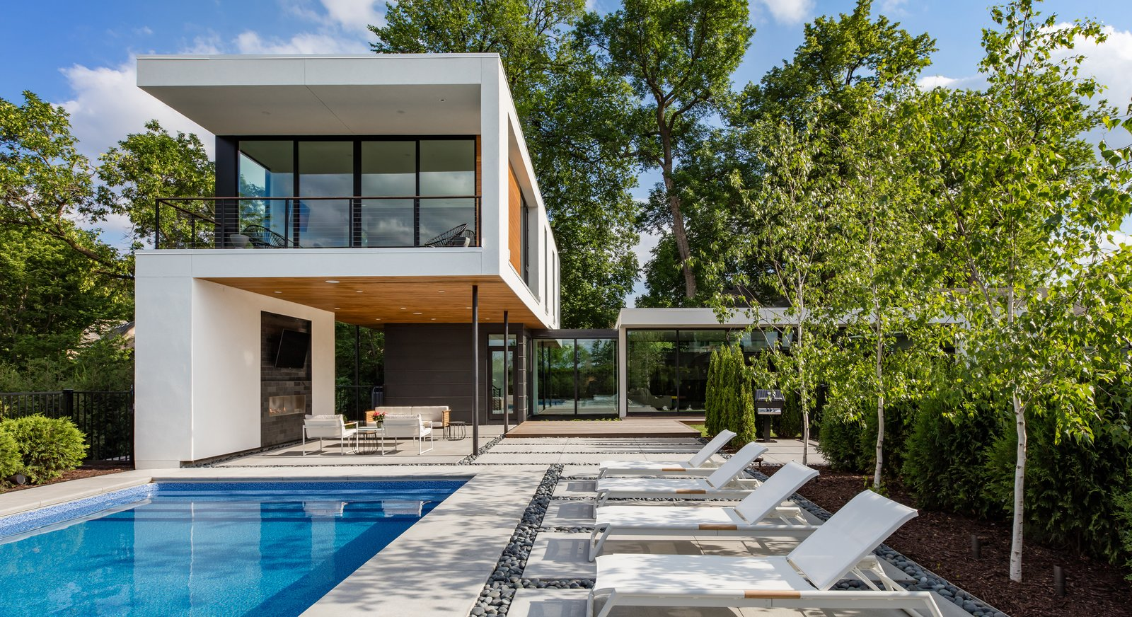 Swimming Pools, Tubs, Shower, Lap Pools, Tubs, Shower, Garden, Prefab Container Pools, Tubs, Shower, Back Yard, Concrete Patio, Porch, Deck, Pavers Patio, Porch, Deck, Stone Patio, Porch, Deck, Gas Burning Fireplace, and Outdoor  Calhoun Pavilions Residence by Peterssen/Keller Architecture