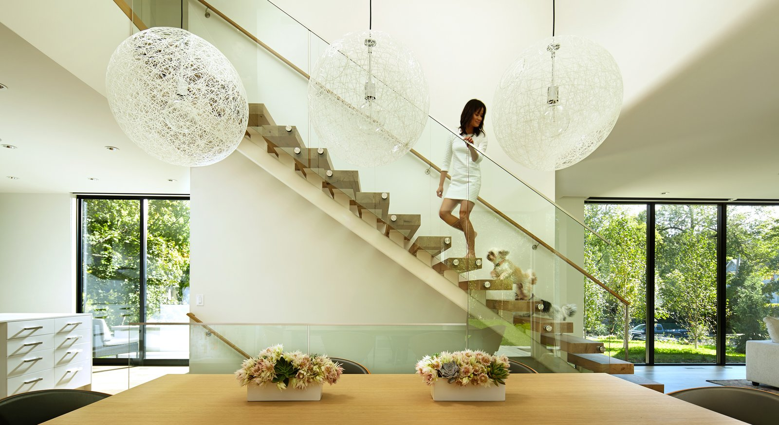 Staircase, Wood Tread, and Glass Railing  Sheridan Residence by Peterssen/Keller Architecture