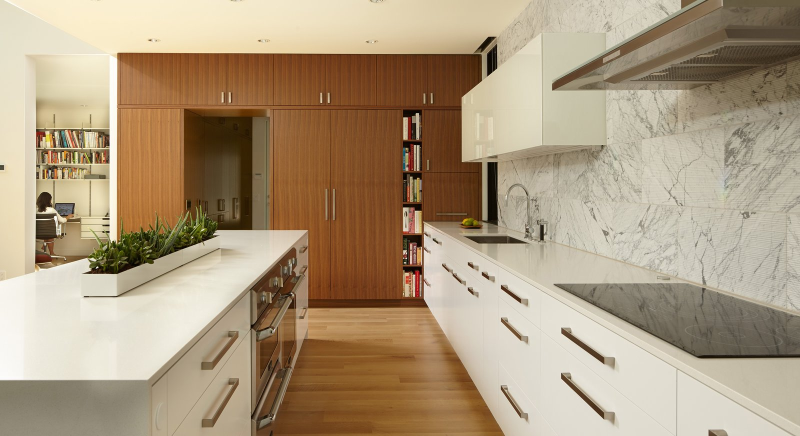 Kitchen, White, Light Hardwood, Engineered Quartz, Wood, Ceiling, Stone Tile, Range Hood, Wall Oven, Refrigerator, Cooktops, and Drop In  Best Kitchen Cooktops Stone Tile Photos from Sheridan Residence