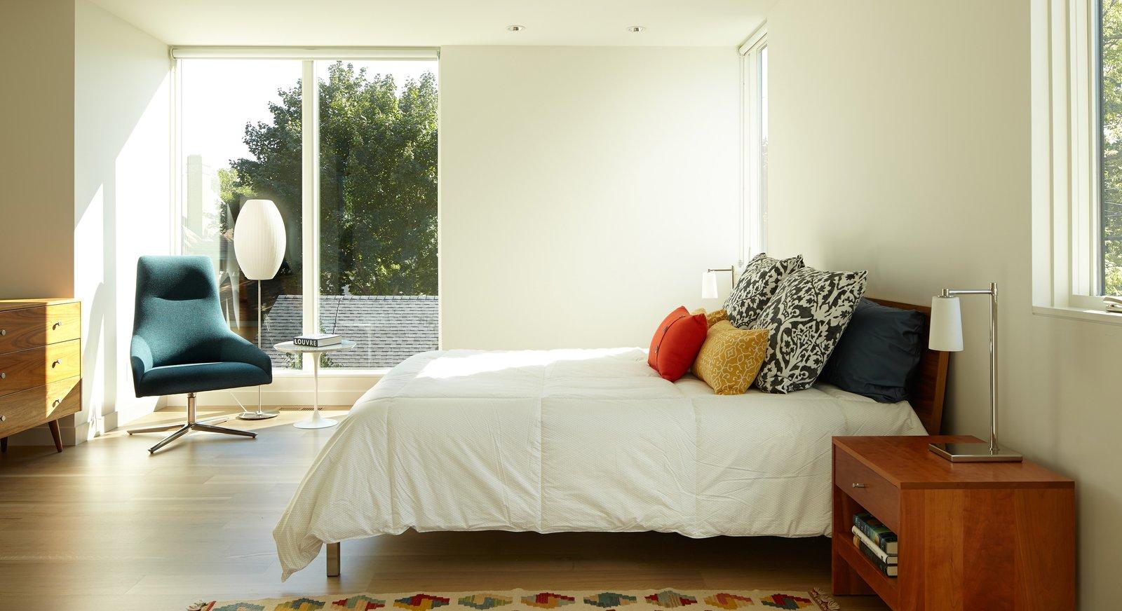 Tagged: Bedroom, Bed, Accent Lighting, Table Lighting, Light Hardwood Floor, and Floor Lighting.  Sheridan Residence by Peterssen/Keller Architecture