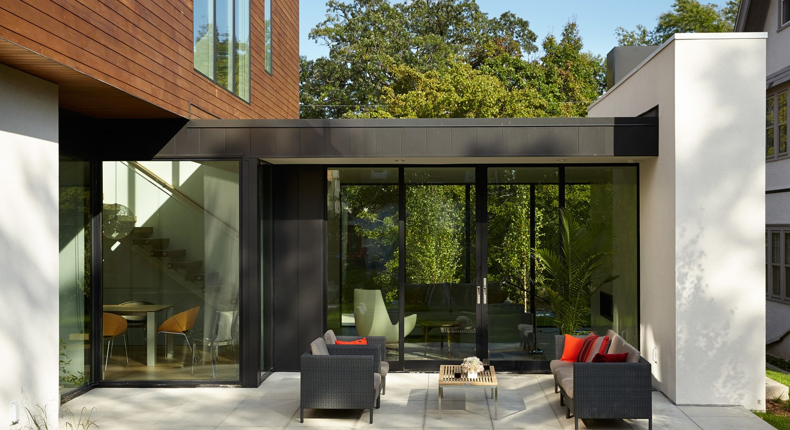 Outdoor, Pavers Patio, Porch, Deck, Wood Patio, Porch, Deck, Metal Patio, Porch, Deck, Concrete Patio, Porch, Deck, Back Yard, Garden, and Trees  Sheridan Residence by Peterssen/Keller Architecture