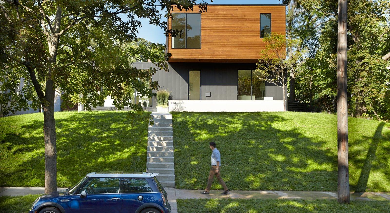 Outdoor, Metal Patio, Porch, Deck, Grass, Front Yard, Trees, Concrete Patio, Porch, Deck, and Wood Patio, Porch, Deck  Sheridan Residence by Peterssen/Keller Architecture