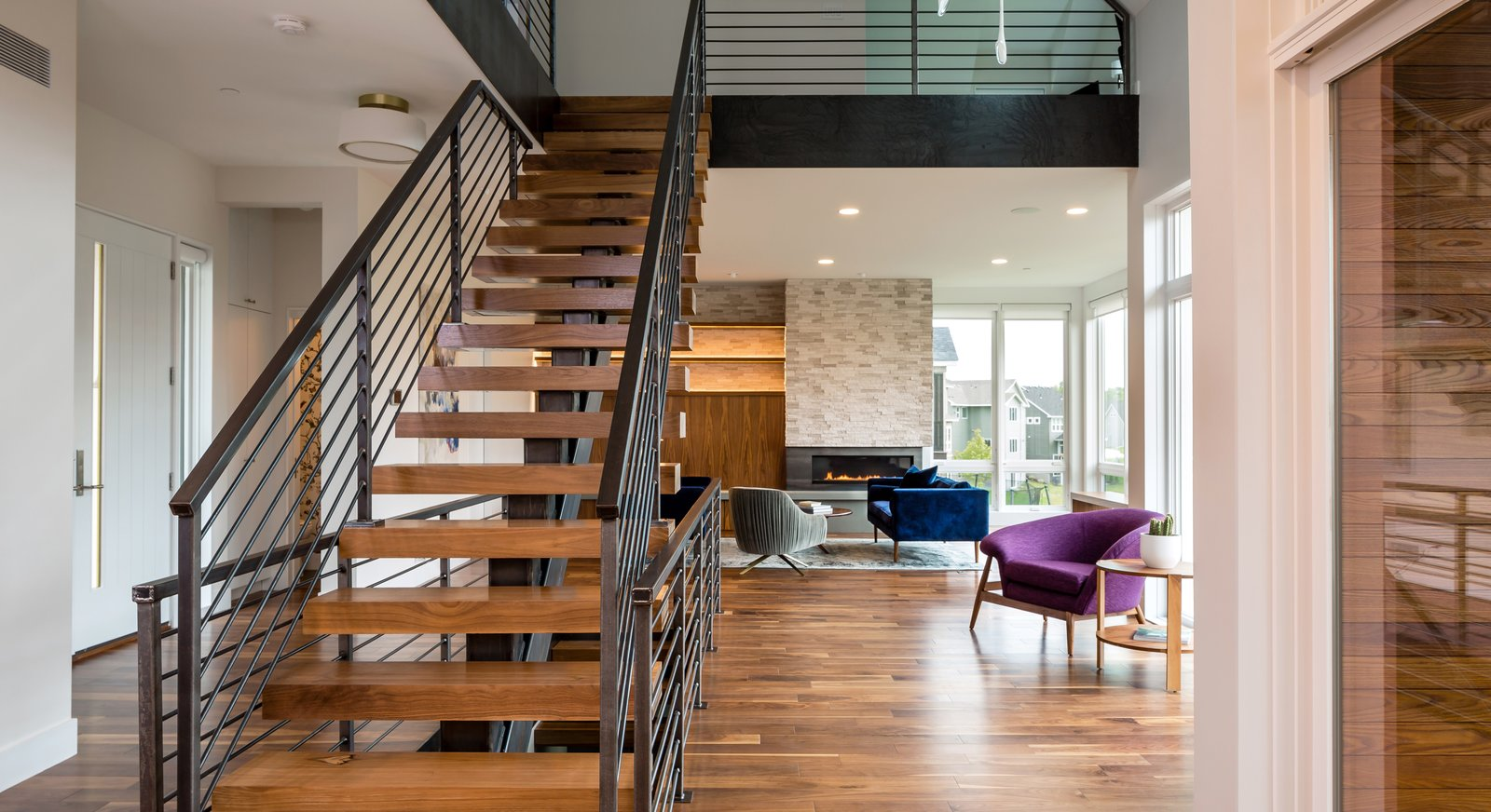 Medium Hardwood, Chair, Staircase, Gas Burning, Sofa, Corner, Wood, Metal, and Metal  Best Staircase Medium Hardwood Sofa Metal Photos from Credit River Residence
