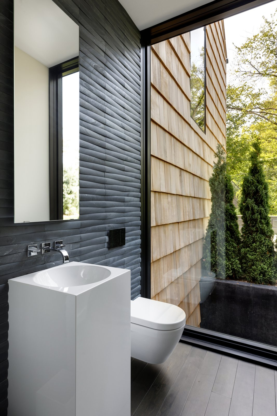Bath Room, Dark Hardwood Floor, and Stone Tile Wall  Photo 9 of 15 in What's the Best Way to Save Space in a Small Bathroom? from Huntington Residence