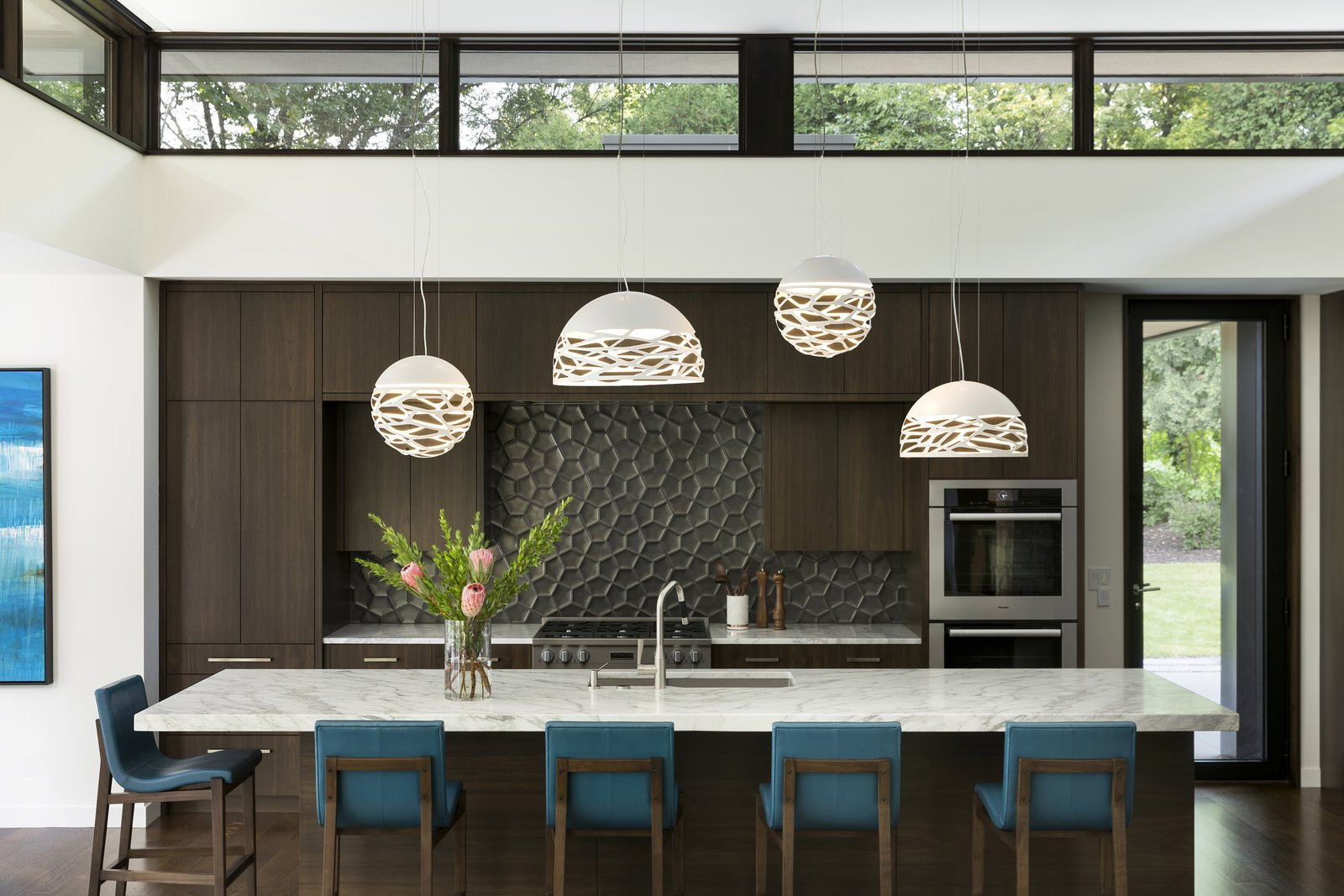 Kitchen, Wall Oven, Cooktops, Engineered Quartz, Medium Hardwood, Ceramic Tile, Mosaic Tile, Pendant, and Undermount  Kitchen Cooktops Undermount Wall Oven Mosaic Tile Photos from Sunfish Lake Residence