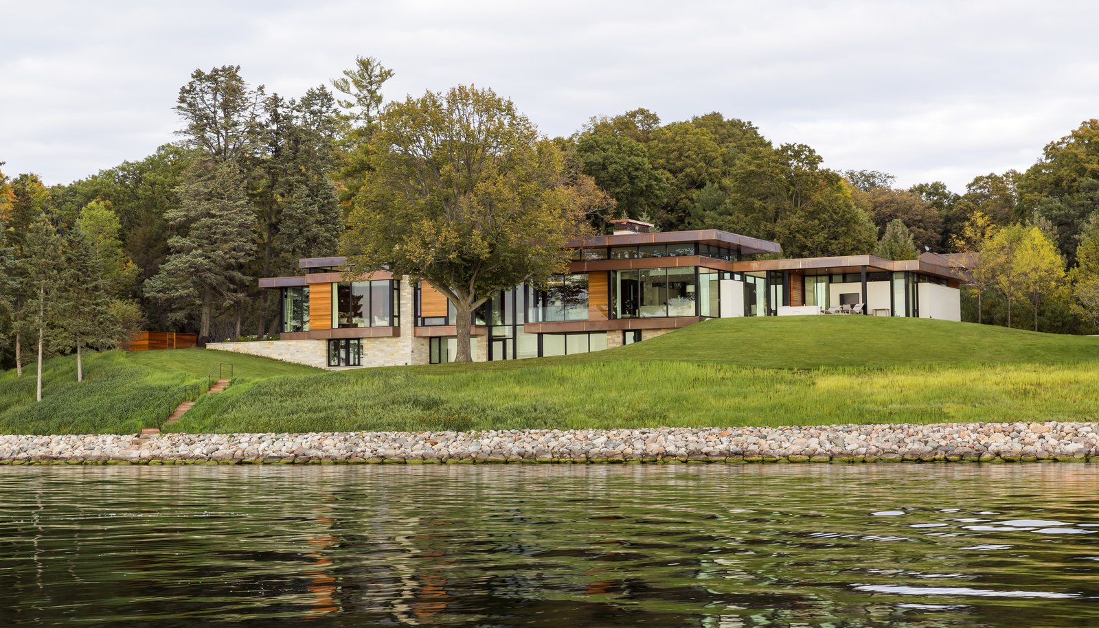 Exterior, Flat RoofLine, Metal Siding Material, House Building Type, Wood Siding Material, Stone Siding Material, Stucco Siding Material, and Metal Roof Material  Shoreline Residence by PKA Architecture