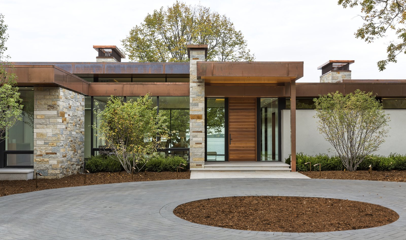 Exterior, Flat RoofLine, Metal Roof Material, Wood Siding Material, House Building Type, Glass Siding Material, Stucco Siding Material, and Stone Siding Material  Shoreline Residence by PKA Architecture