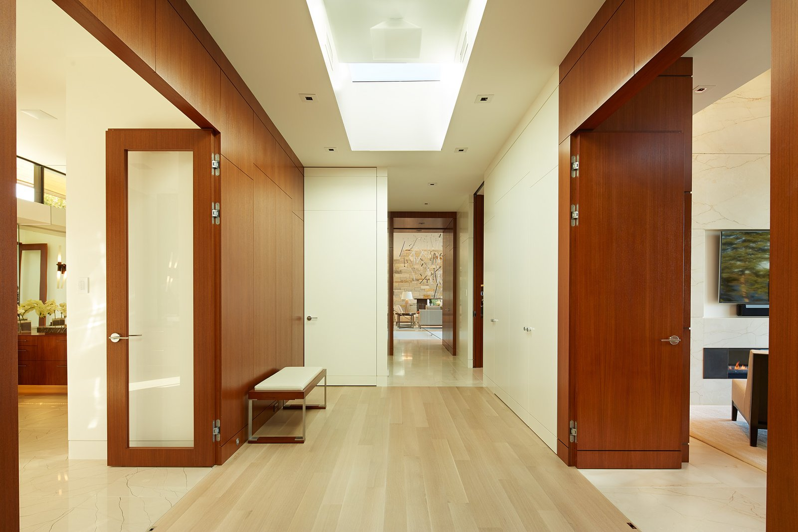 Hallway and Light Hardwood Floor  Shoreline Residence by PKA Architecture