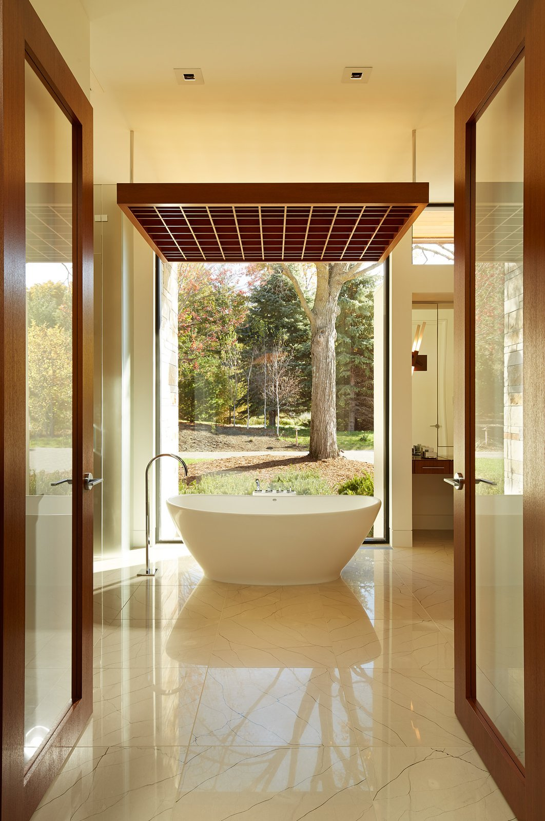 Bath Room, Freestanding Tub, Wood Counter, Ceramic Tile Floor, Recessed Lighting, and Wall Lighting  Shoreline Residence by PKA Architecture