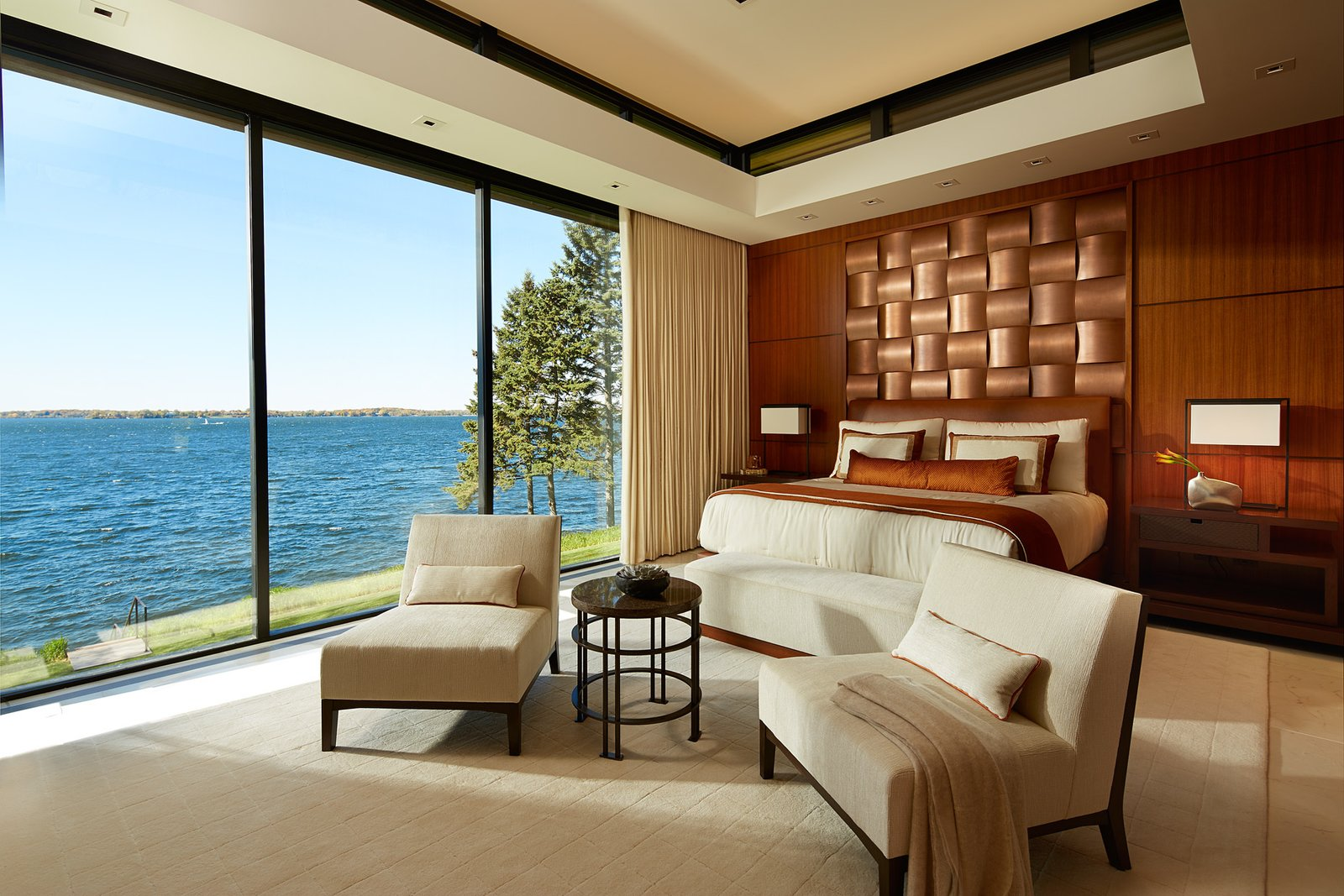Bedroom, Bed, Chair, Night Stands, Recessed Lighting, Rug Floor, and Table Lighting  Shoreline Residence by PKA Architecture