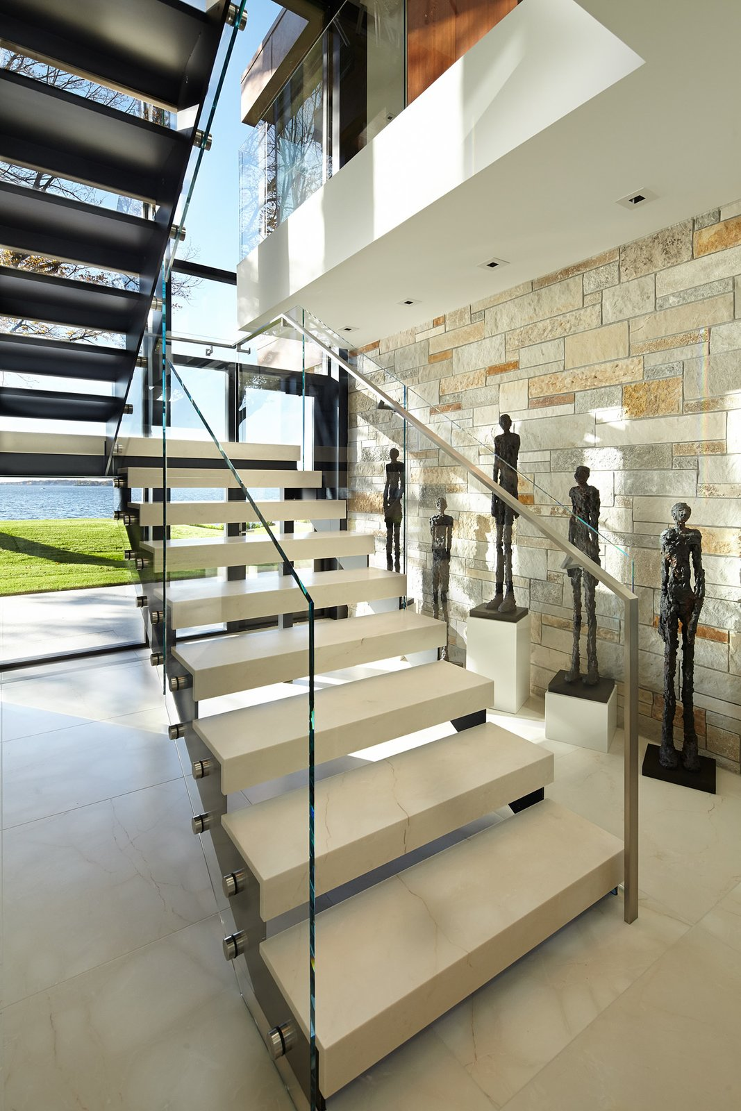 Staircase, Metal Railing, and Stone Tread  Shoreline Residence by PKA Architecture
