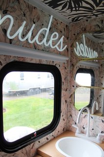 A Portland Couple Renovate a 1982 RV, Turning It Into Their New Home - Photo 10 of 12 - Kamarul gave the bathroom a playful upgrade with pink flamingo wallpaper and a neon sign.
