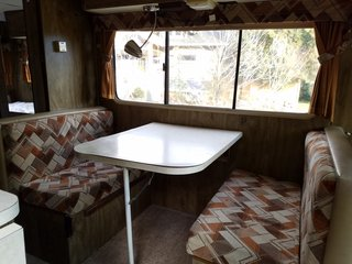 The Winnebago's original dinette area before they renovated it.