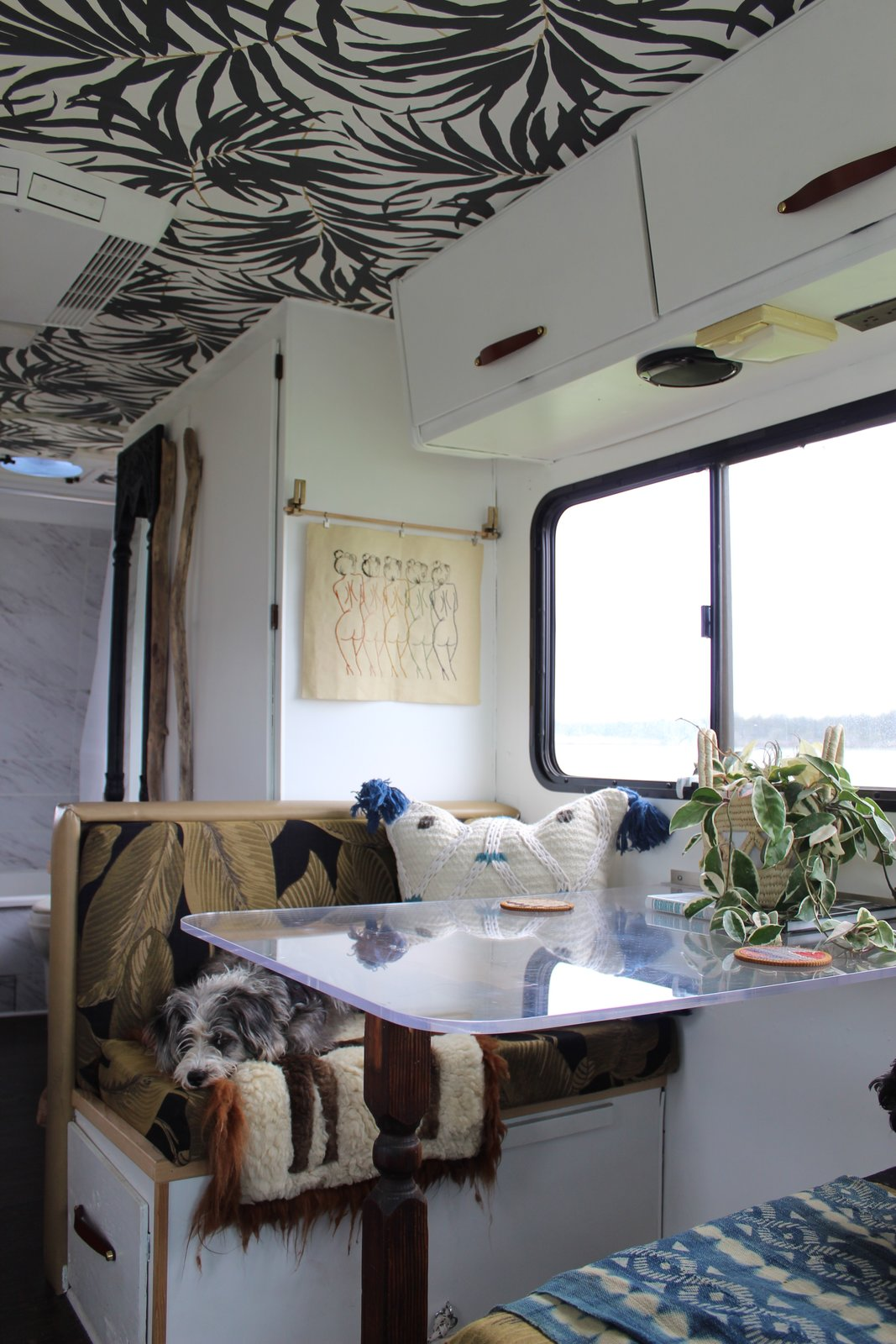 Kamarul used an acrylic table top for the dinet to open up the space visually.  Photo 8 of 13 in A Portland Couple Renovate a 1982 RV, Turning It Into Their New Home