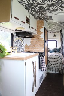 A Portland Couple Renovate a 1982 RV, Turning It Into Their New Home - Photo 9 of 12 - Kamarul added depth to one side of the kitchen by cascading triangles made out of plywood down the wall.
