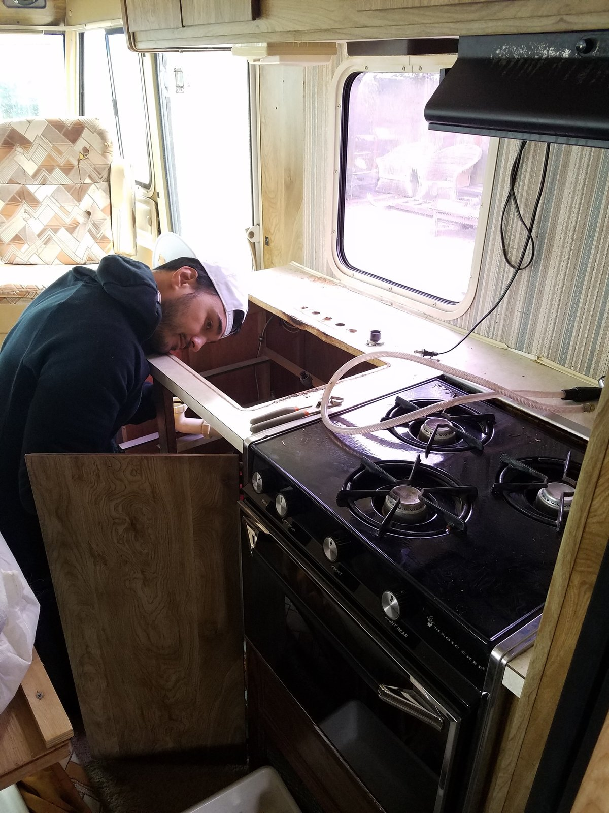 Tim Kamarul working on the RV's plumbing.  Photo 6 of 13 in A Portland Couple Renovate a 1982 RV, Turning It Into Their New Home