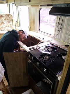 Tim Kamarul working on the RV's plumbing.