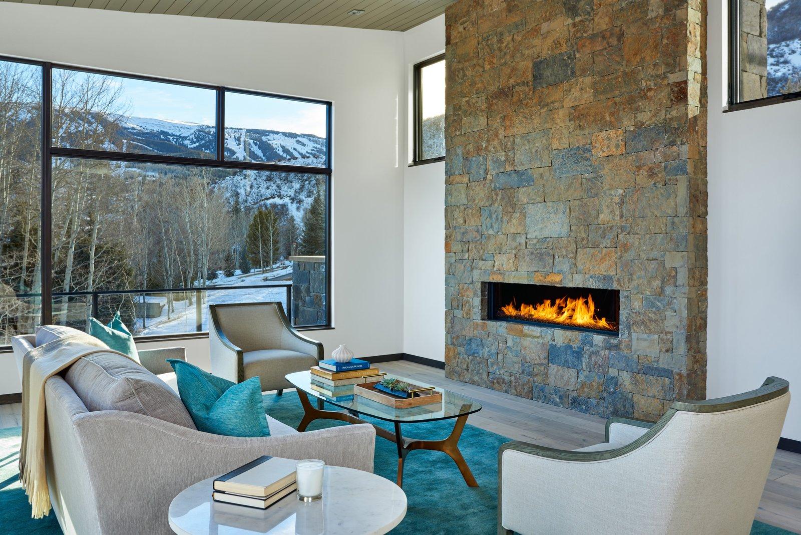 Living Room, Gas Burning Fireplace, Chair, Medium Hardwood Floor, Ceiling Lighting, Sofa, Coffee Tables, and Ribbon Fireplace  Terrace Drive by KA DesignWorks
