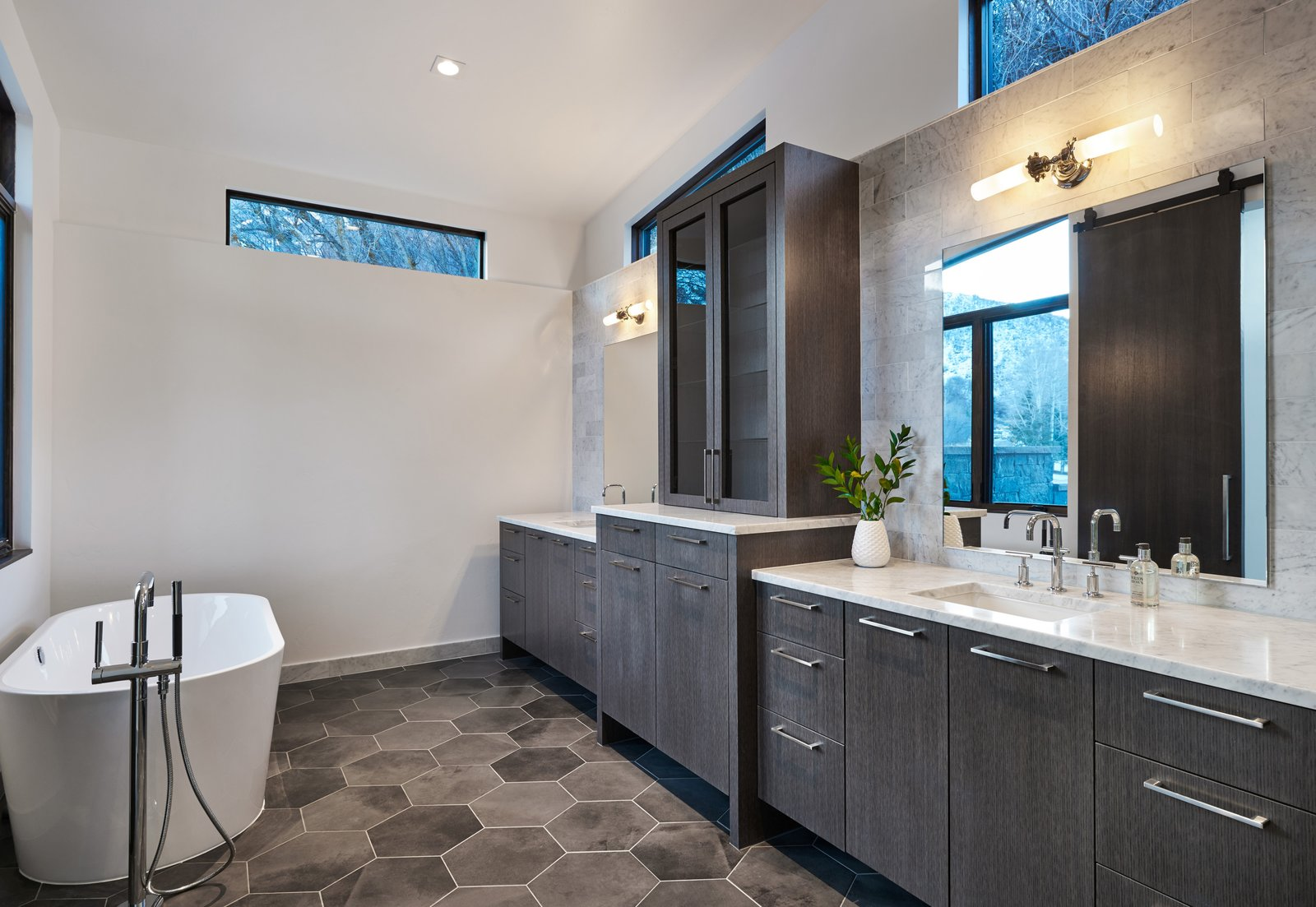 Bath Room, Stone Tile Wall, Undermount Sink, Ceiling Lighting, Marble Counter, Freestanding Tub, Porcelain Tile Floor, and Accent Lighting  Terrace Drive by KA DesignWorks