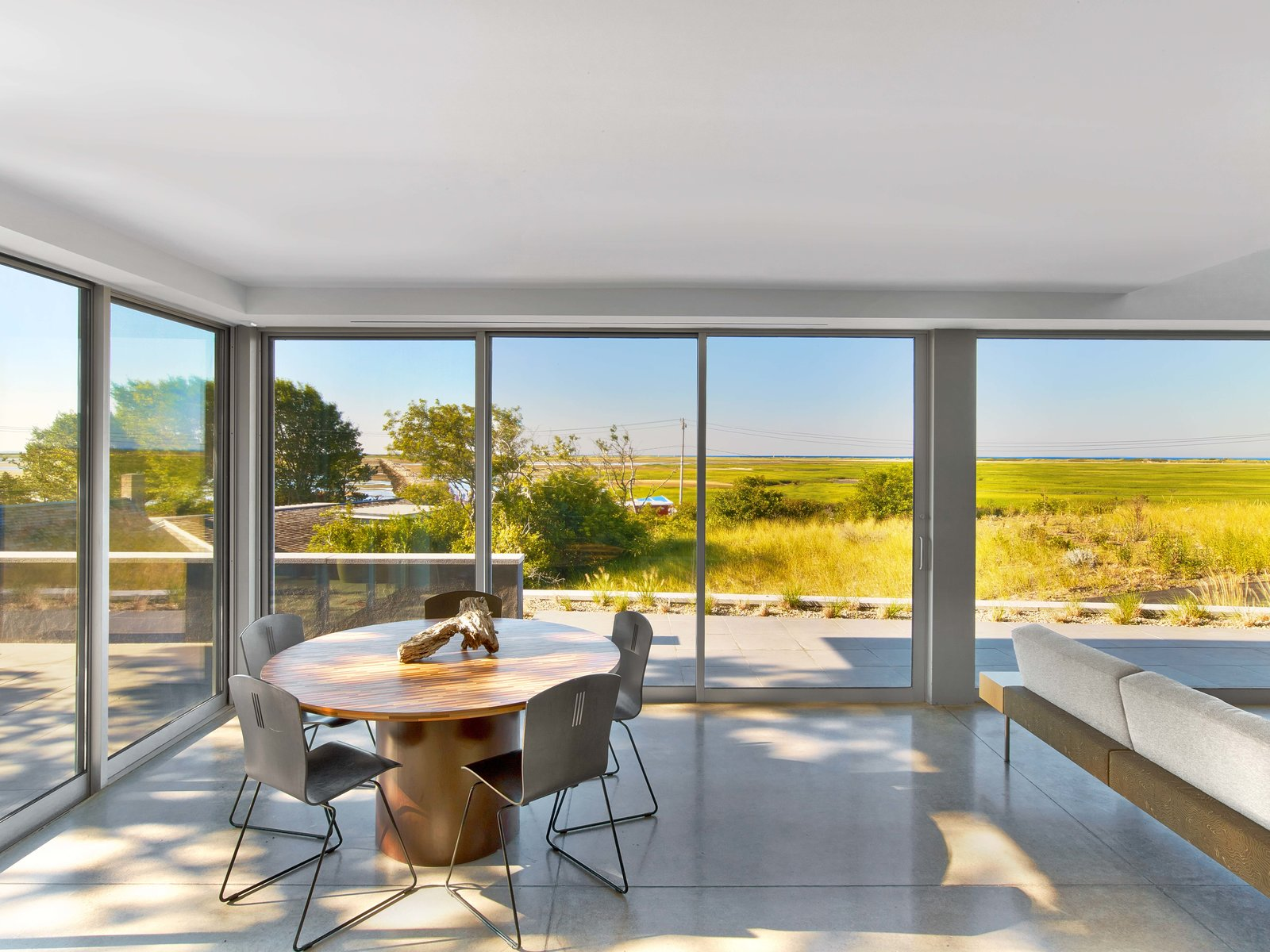 Dining Room, Table, Chair, and Concrete Floor  Cape Cod - Beach House by Hariri & Hariri Architecture